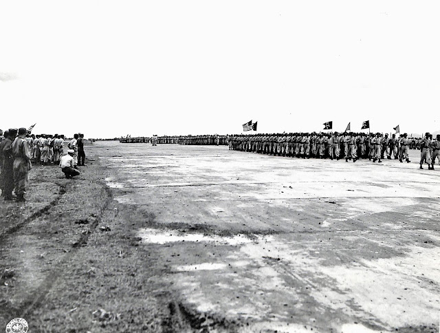 Passing in review at Lipa Airstrip in 1945.  Image source:  United States National Archives.