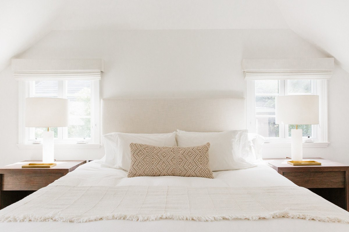 White serene calm bedroom with symmetry and quiet tones by Erin Fetherston