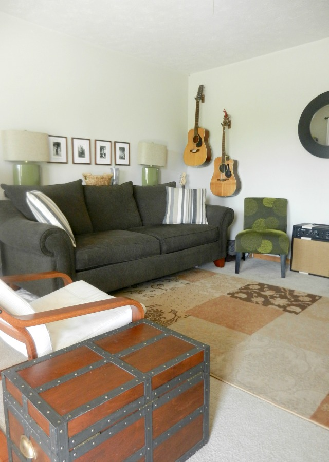 green accent chairs in small living room