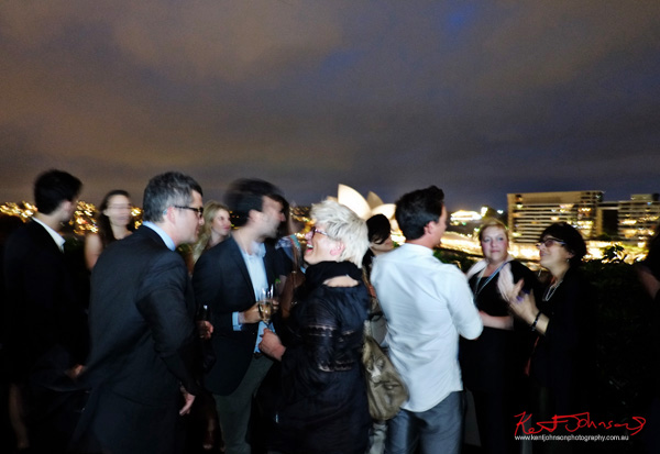 Guest mingle on the deck of the MCA with the Sydney Opera House in the background, Connect Italy 2017, Sydney, Australia. Street Fashion Sydney by Kent Johnson.