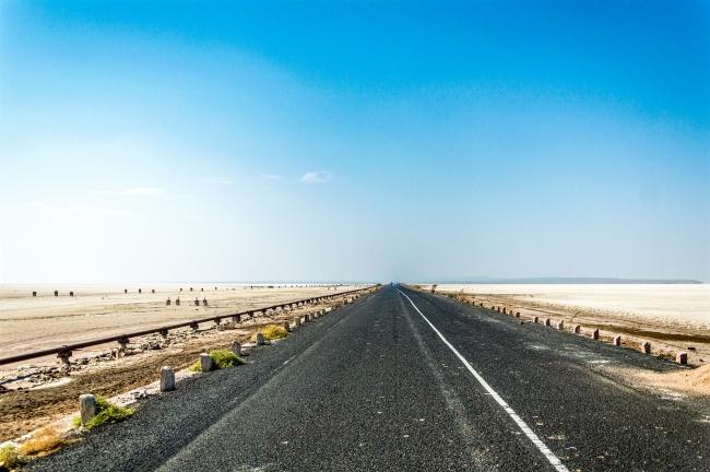 Straight road through the white desert