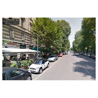 Leafy Via Sanzio with many restaurants, near Piazza Wagner and Via Marghera