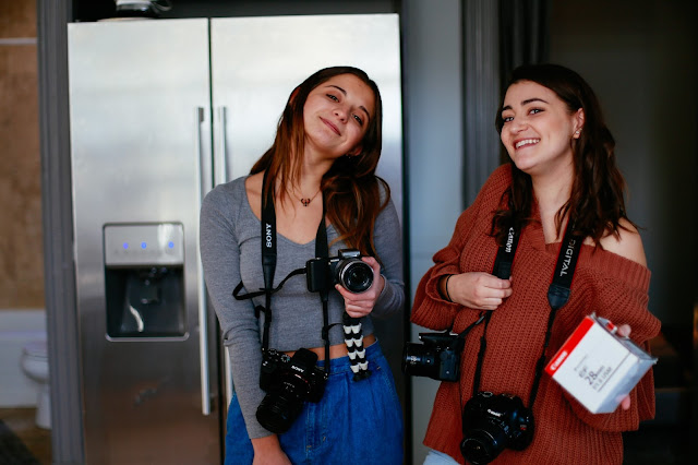 happy assistant bloggers with canon cameras
