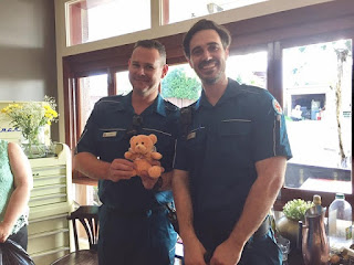 QAS receiving care bears from Quota International of Carindale