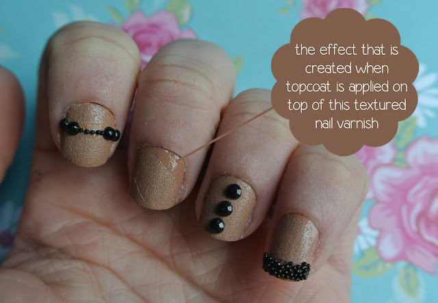 leather effect tan polish with black studs