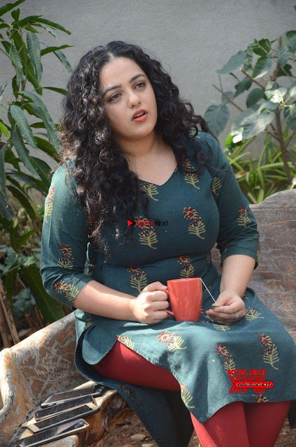 Nithya Menon promotes her latest movie in Green Tight Dress ~  Exclusive Galleries 002.jpg