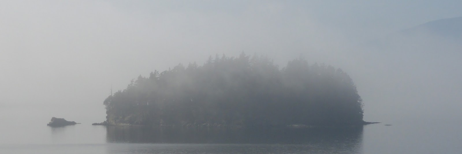 Chuckanut island in the fog off the coast of Bellingham, near the Canadian border
