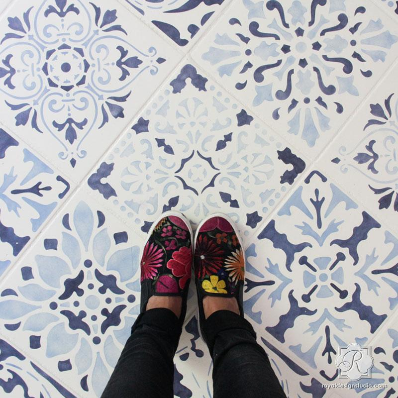 Blue and white stenciled floor tiles for handpainted look on Hello Lovely Studio