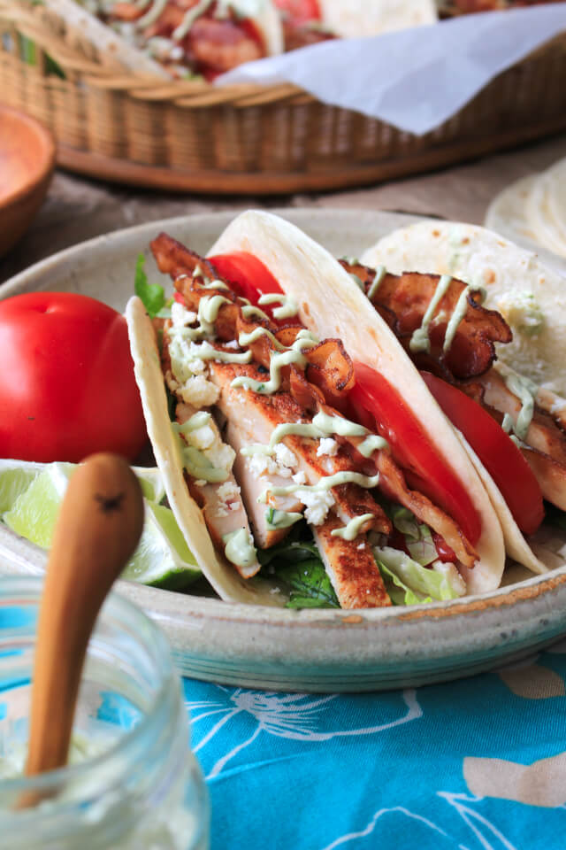 BLT Grilled Chicken Tacos are a fresh and summery twist on tacos made with classic BLT ingredients, dry-rubbed grilled chicken, and a cool avocado ranch drizzle. #MissionOrganics #ad @missionfoods