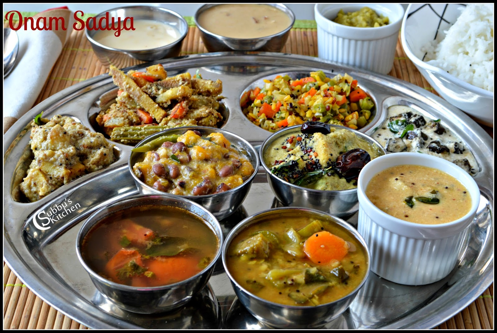 Onam Sadya (Onam Festival Lunch Menu) - Sambar, Rasam, Puliseri, Eriseri, Olan, Kalan, Aviyal, Kadamba thoran, Kadala Paruppu Pradaman, Pal Payasam, Thayir Pachadi, Rice and Pappad