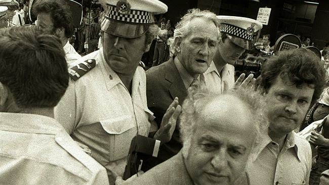 Tom Uren (centre) is arrested in Brisbane, 1978. Senator George Georges is in the foreground.