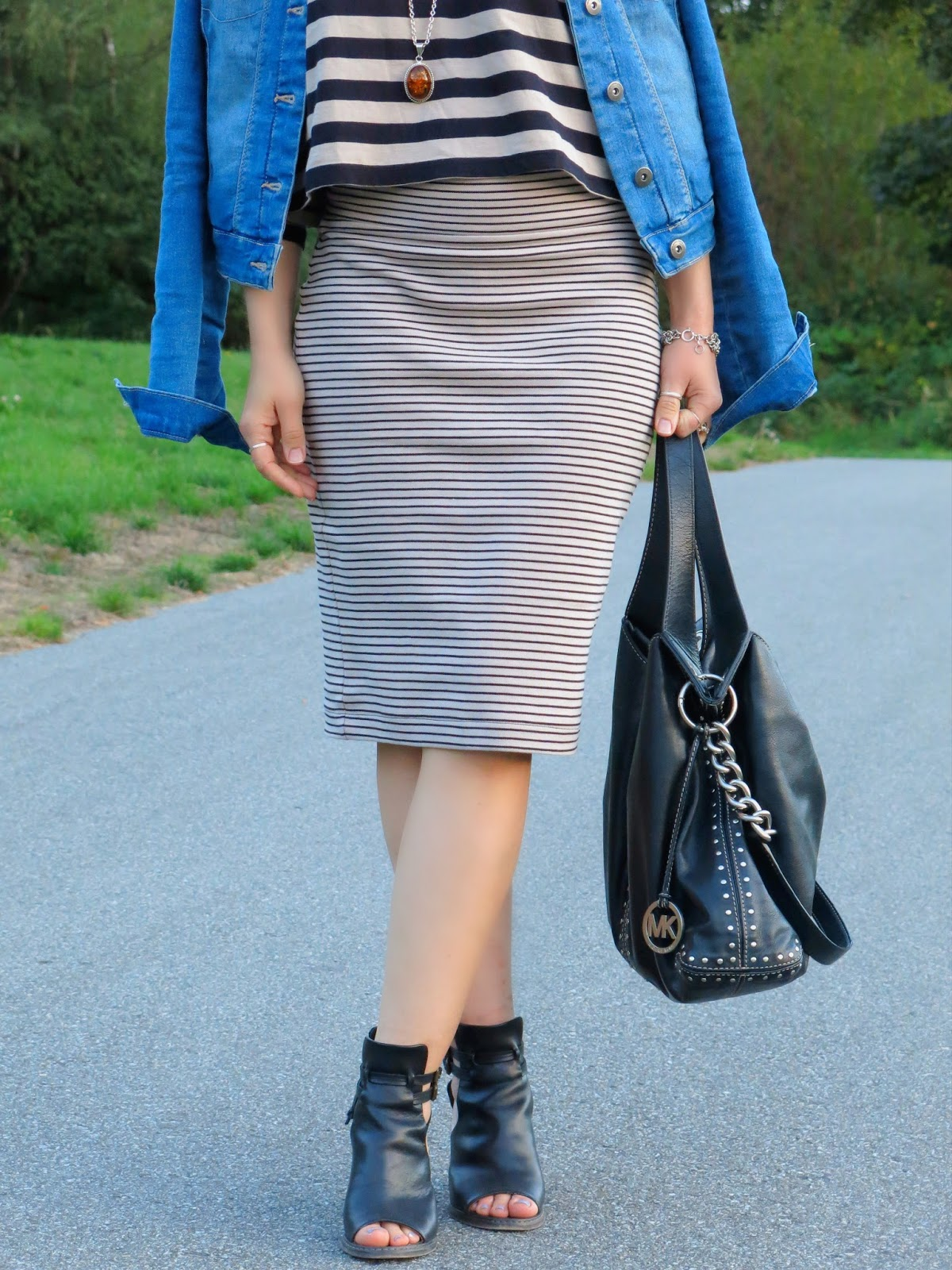styling a monochromatic striped pencil skirt and crop top with a denim jacket