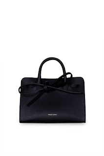 http://www.laprendo.com/products/42363/MANSUR-GAVRIEL/Mansur-Gavriel-Vegetable-Tan-Mini-Mini-Sun-Bag-Black--Flamma
