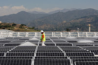 Solar worker (Photograph Credit: David McNew | Getty) Click to Enlarge.