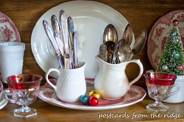 Love the vintage silver in the creamer pitchers! Lots of other pretty Christmas decorating ideas on this site.