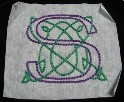 Complete Celtic monogram S design with stabilizer still attached