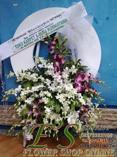 karangan bunga turut berduka cita