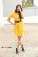 Actress Poojitha Stills in Yellow Short Dress at Darshakudu Movie Teaser Launch .COM 0018.JPG