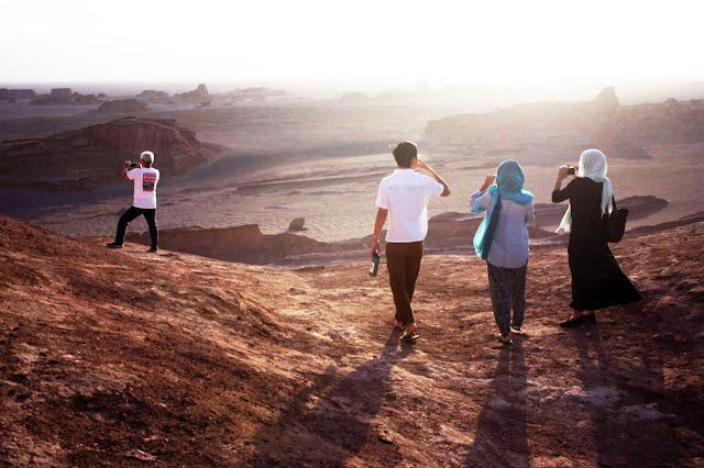 Travelers visiting Shahdad desert. Kerman-Iran