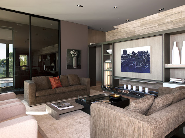 Photo of modern luxury house interiors with brown furniture and dark brown walls