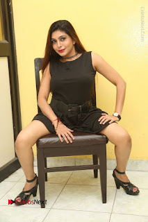 Tollywood Upcoming Actress Pooja Roshan Stills in Black Short Dress at Plus 1 Movie Trailer Launch  0304.JPG