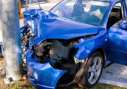 Who determines how much my totaled car is worth?