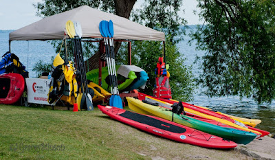 Vendor at the Scottish Festival for Paddle boards and kayaks, on display at Couchiching Beach Park