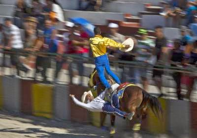 two stunt riders race around the arena