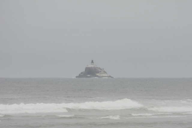 Tillamook Rock Lighthouse slightly in the distance in the Pacific Ocean.