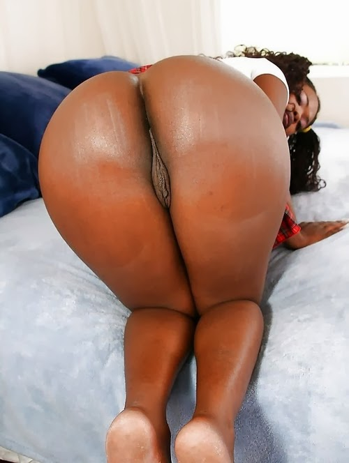 Divine black babe shows off her shaved pussy and juicy ass.