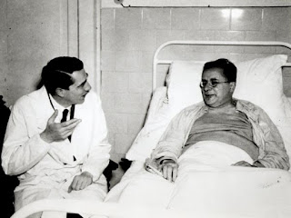 Togliatti, pictured with the surgeon, Pietro Valdoni, who saved his life, recovers in hospital after the assassination attempt.
