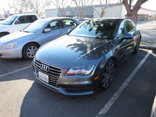 Audi A7 after dent repaired in hood prior at Almost Everything Auto Body