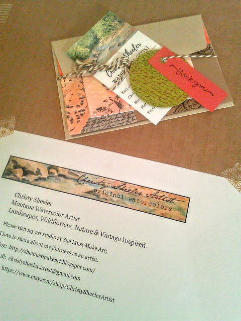 Christy Sheeler Artist information attached to the front of the cardboard protective packaging and handmade note card.
