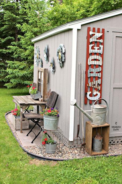 Decorating a Garden Shed Kit #gardenshed #junkgarden #gardenjunk #containergarden #gardensigns #galvanized