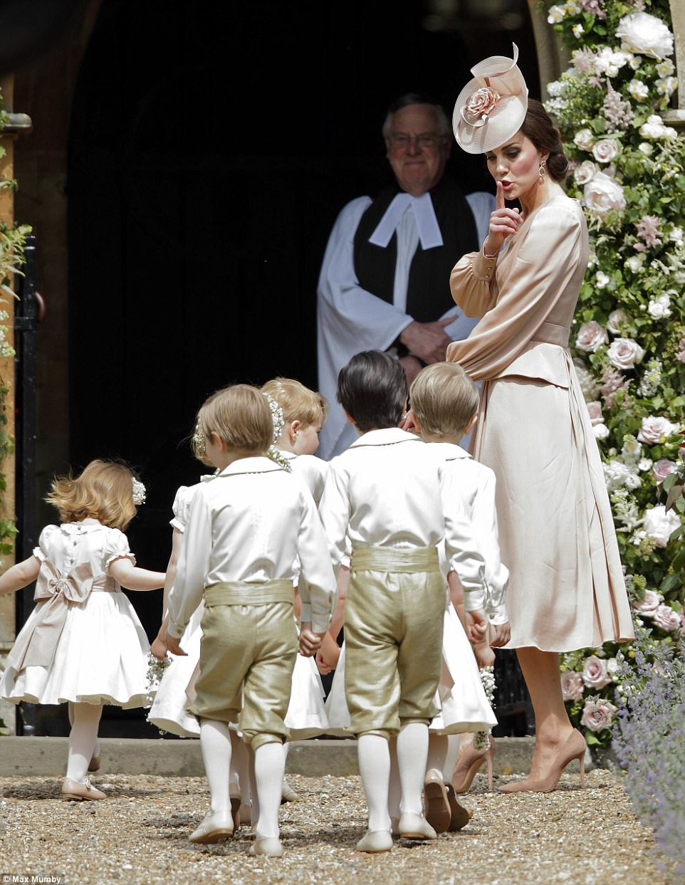 Kate Middleton stays low-key in peach at Pippa's wedding