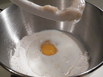 flour and eggs in a mixing bowl