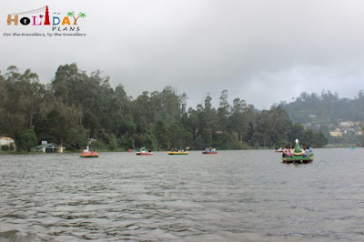 People enjoying boating at kodai lake