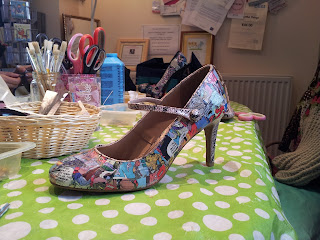 Shoe decorated with random pieces from a comic book