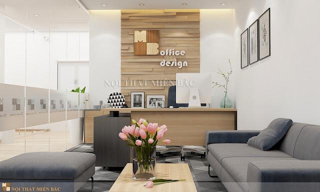 Thiết kế nội thất phòng giám đốc với chiếc bàn giám đốc bằng gỗ công nghiệp cao cấp kết hợp với bộ ghế sofa màu sắc nhã nhặn
