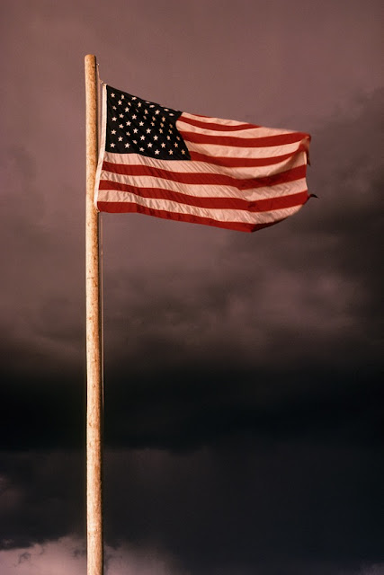 American flag against dark sky