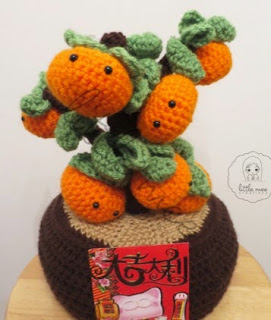 http://translate.google.es/translate?hl=es&sl=en&u=http://littlemeecreations.com/good-fortune-clementine-tree/&prev=search
