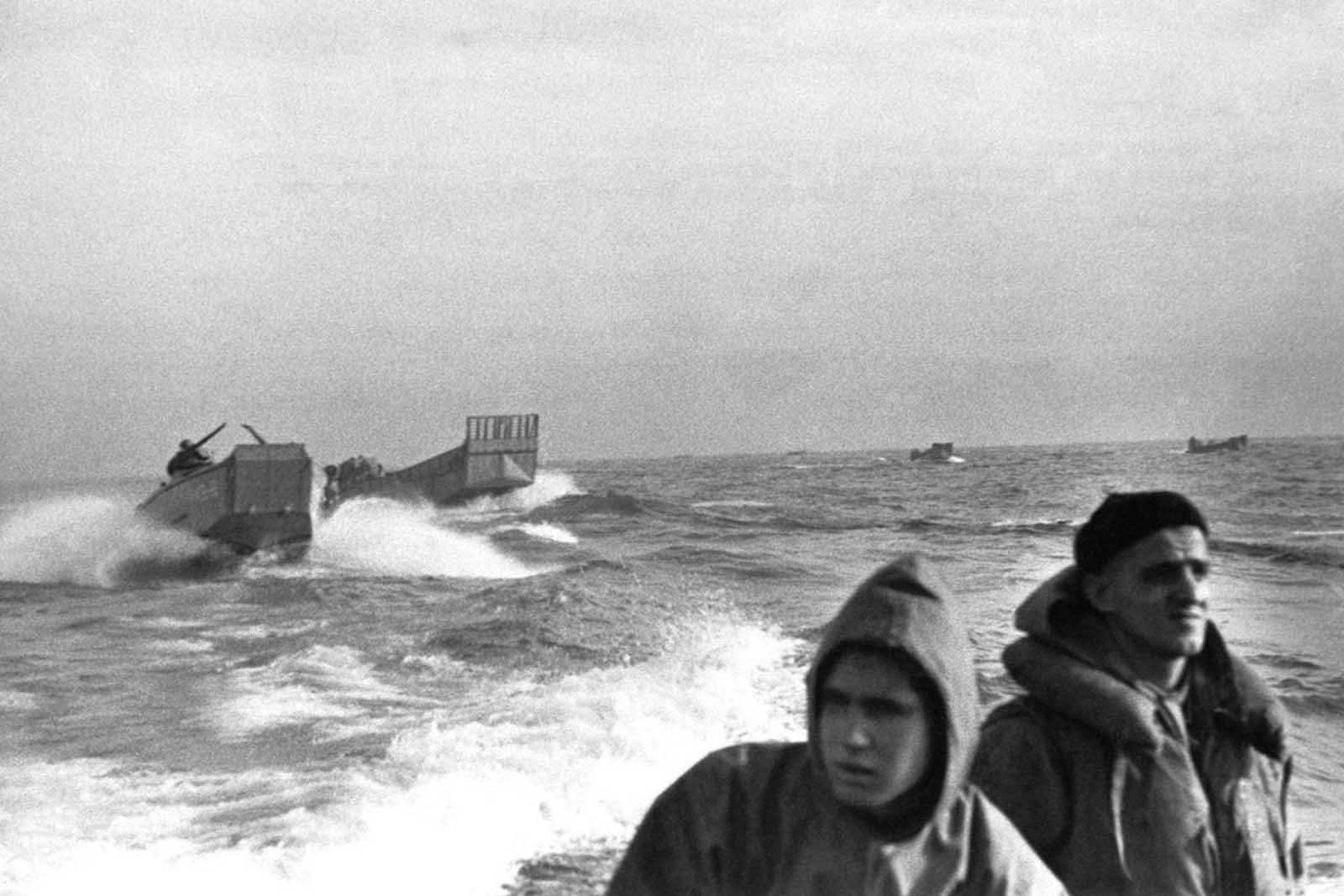 U.S. landing barges speed shoreward off Fedala, French Morocco during landing operations in early November, 1942. Fedala is about 15 miles north of Casablanca, French Moroccan city.