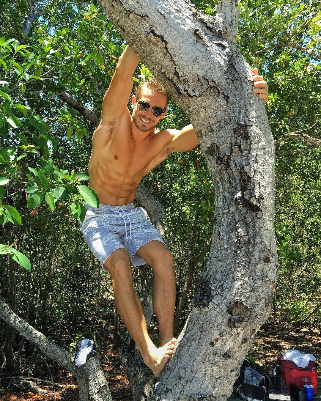 sexy-man-shades-ripped-abs-tree