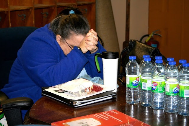Maggie, pondering - or perhaps just resting her eyes after a long day teaching