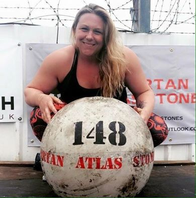 Donna Moore Breaks Atlas Stone World Record.  StrengthFighter.com