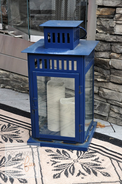 Outdoor candles inside lantern :: OrganizingMadeFun.com