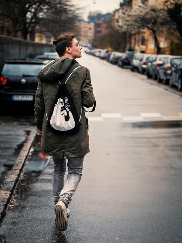 Person Wearing Blue Jeans with Black and White Drawstring Bag HD Copyright Free Image