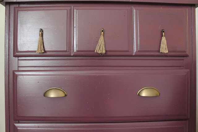 luxe purple dresser with tassel and brass pulls