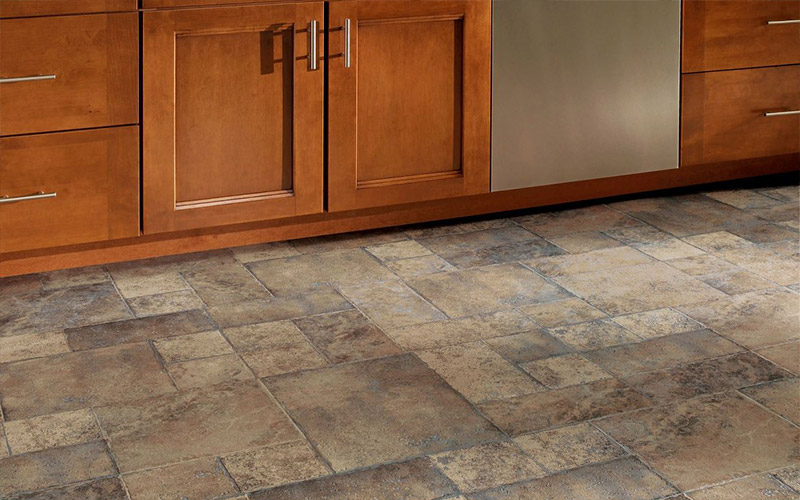 Ceramic tile of different sizes and shapes make a beautiful kitchen floor