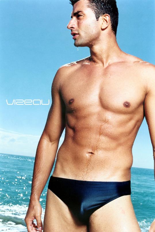 The versatile male model Fabrizio wearing the basic 0188 swim brief by Vizeau Swimwear